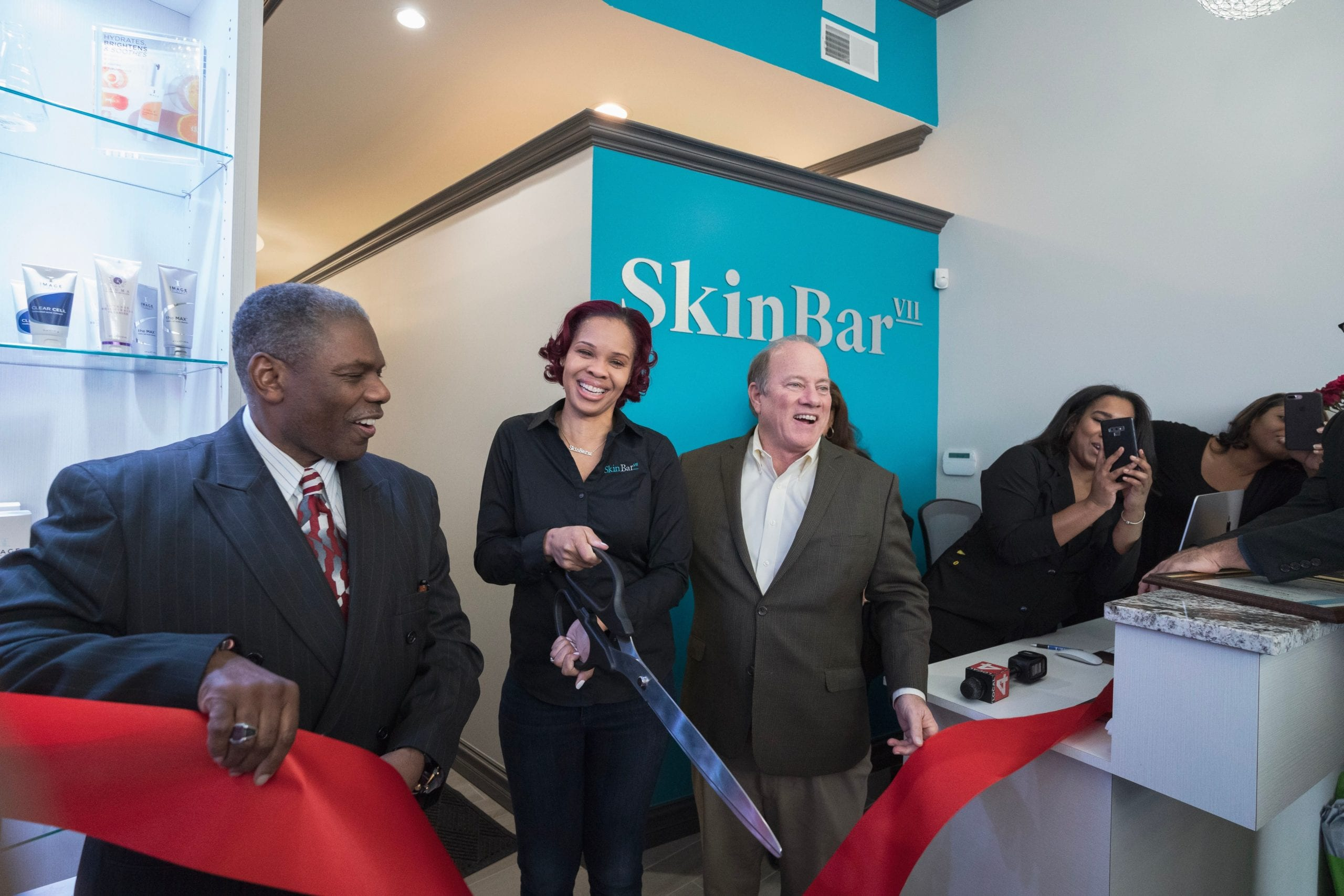 Sevyn Jones cuts ribbon at the grand opening ceremony for Skin Bar VII