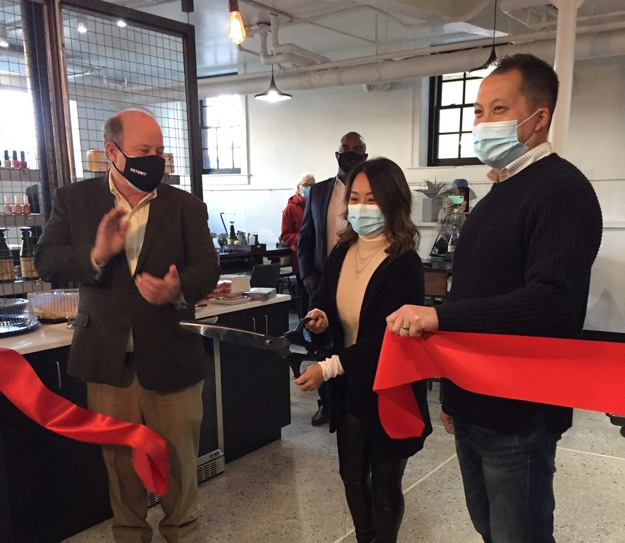 Owner cutting ribbon at ceremony