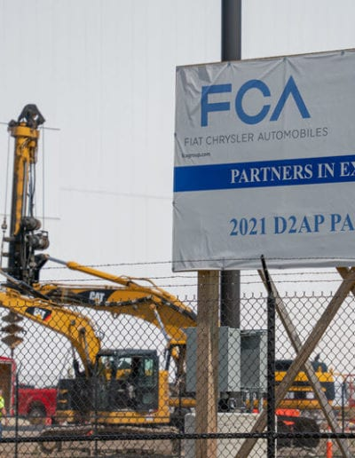 Construction site with an FCA billboard in the front.